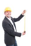 Smiling architect posing measuring with ruler tape Stock Image