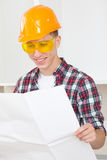 Smiling architect  with repair plan Royalty Free Stock Photos