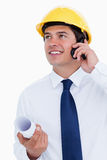 Smiling architect talking on his cellphone. Close up of smiling architect talking on his cellphone against a white background Stock Photography