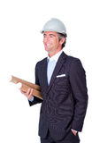 Smiling architect wearing a hardhat. Isolated on a white background Royalty Free Stock Photography