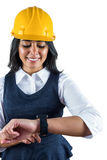 Smiling architect wearing her safety hat Royalty Free Stock Photos