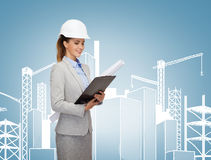 Smiling architect in white helmet with blueprints Stock Photos