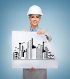 Smiling architect in white helmet with blueprints Royalty Free Stock Photo