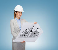 Smiling architect in white helmet with blueprints Stock Image