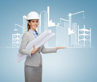 Smiling architect in white helmet with blueprints Royalty Free Stock Photography