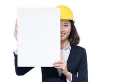 Smiling architect woman hold blank sign board. Isolated portrait Royalty Free Stock Photo