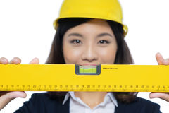 Smiling architect woman holding yellow ruler isolated on white. Stock Photos