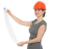 Smiling architect woman with open flip chart Royalty Free Stock Images