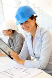 Smiling architect at work. Portrait of attractive architect wearing security helmet Royalty Free Stock Photo
