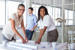 Smiling architects analyzing plans together Royalty Free Stock Photo