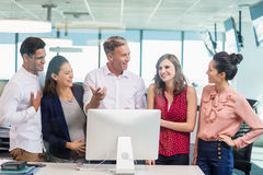 Smiling architects discussing with each other. In office Royalty Free Stock Photo