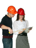Smiling architects in hardhats Stock Images