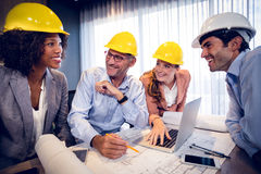 Smiling architects interacting with each other. In office Stock Images