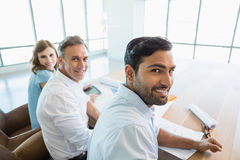 Smiling architects sitting together in office. Portrait of smiling architects sitting together in office Stock Image