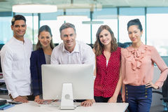 Smiling architects standing together in office. Portrait of smiling architects standing together in office Royalty Free Stock Photography