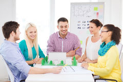 Smiling architects working in office Stock Photos
