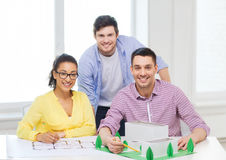 Smiling architects working in office Stock Photo