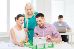 Smiling architects working in office Royalty Free Stock Image