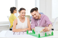 Smiling architects working in office Stock Photography