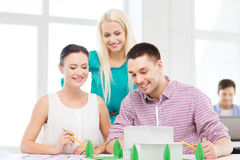 Smiling architects working in office Stock Images