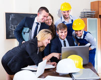 Smiling architectural engineers having meeting Royalty Free Stock Image