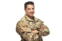 Smiling Army Soldier. Happy Army Soldier with arms crossed looking at camera with white background royalty free stock photo