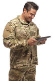 Smiling Army Soldier with tablet in hand Stock Images