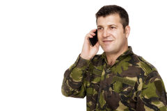 Smiling army veteran on the phone Royalty Free Stock Images