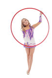 Smiling artistic gymnast posing with red hoop Royalty Free Stock Images