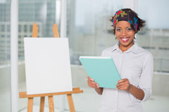 Smiling artistic woman holding sketchpad Royalty Free Stock Photos
