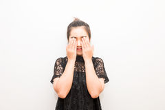 Smiling asia woman closing eyes with her hands.  Stock Photos