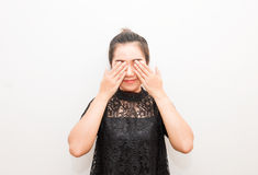 Smiling Asia woman covering eyes with her hands.  Royalty Free Stock Image