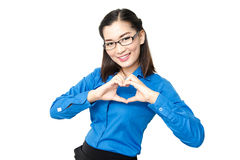Smiling asia young lady with heart sign looking at camera front Royalty Free Stock Image