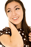 Smiling Asian American teen girl looking away arm up Royalty Free Stock Photography