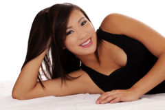 Smiling Asian American Teen Girl Reclining On Side Stock Photo
