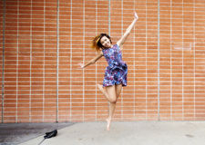 Smiling Asian American Woman Jumping In Dress Royalty Free Stock Image