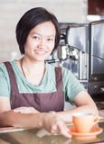 Smiling asian barista   posing with cup of coffee Stock Photography