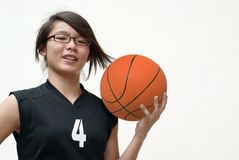 Smiling asian basketball player Royalty Free Stock Photos