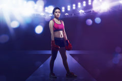 Smiling asian boxer woman with boxing glove royalty free stock photo