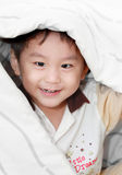 Smiling asian boy covered by blanket Stock Photography