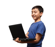 Smiling asian boy with laptop Royalty Free Stock Photography