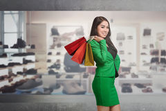 Smiling asian business female holding shopping bag Royalty Free Stock Photo