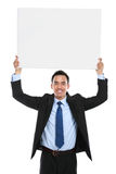 Smiling asian business man holding empty board Stock Image