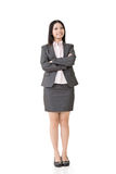 Smiling asian business woman with crossed arms Stock Photo