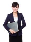 Smiling asian business woman holding laptop Stock Photos