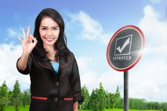 Smiling asian business woman showing OK sign with her hands. Business concept Stock Photo