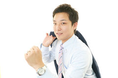 Smiling Asian businessman royalty free stock image