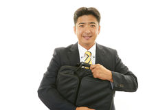 Smiling Asian businessman royalty free stock photo