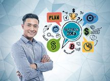 Smiling Asian businessman, business idea stock images