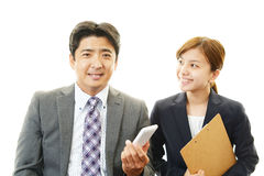 Smiling Asian businessman and business woman Stock Photography